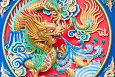 Golden Dragon Spit Water Royalty Free Stock Photo