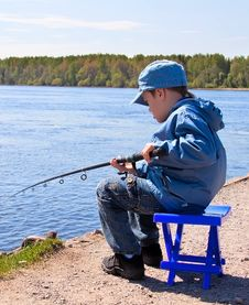 Free Boy Is Catching Fish Royalty Free Stock Photos - 19613348