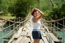 Free The Girl Goes On A Bridge Royalty Free Stock Images - 19615149