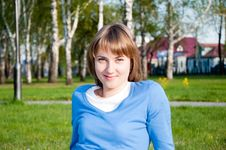 Smiling Girl Sitting In The Park Stock Image