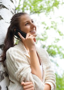 Free Woman Talking On Her Mobile Phone Stock Images - 19615464
