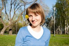 Smiling Girl Sitting In The Park Stock Photos
