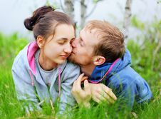 Portrait Of A Happy Couple Lying Together On Grass Royalty Free Stock Image