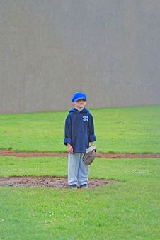 Free T-Ball Player Standing In The Rain Royalty Free Stock Photos - 19615958