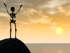 Skeleton Climber Silhouette On Top Of Rock Stock Photos