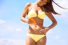 Free Woman In Bikini Smear Protective Cream Stock Images - 19616654