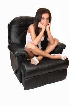 Girl Sitting On Armchair. Stock Photos