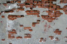 Partially Plastered Wall With Red Bricks