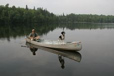 Free Canoeist And Dog Stock Photo - 19620270