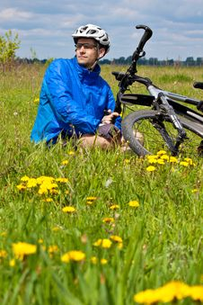 Free Mountain Biker Resting In A Grass Royalty Free Stock Image - 19623916