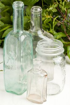 Vintage Bottles And Empty Pot Stock Photo