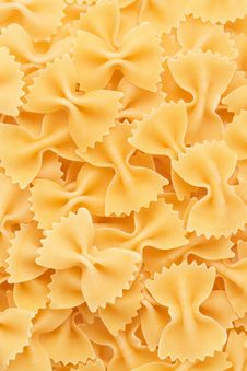 Free Bow Tie Pasta Forming A Background Stock Image - 19628511