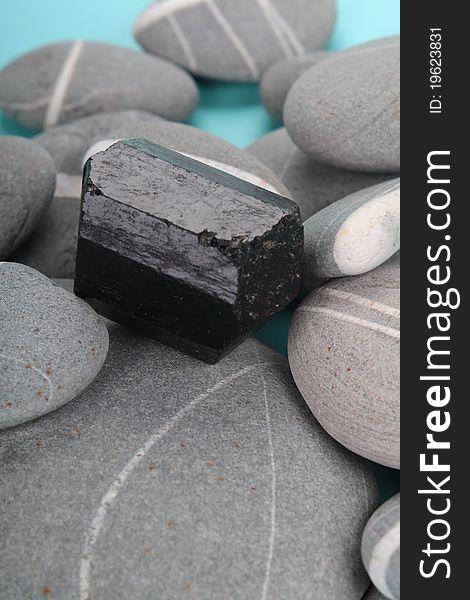 Obsidian over rocks