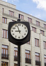 Free Street Clock In Front Of A Building Royalty Free Stock Photo - 19630295