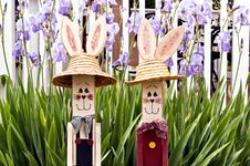 Free Wooden Rabbits In Front Of Flowers Royalty Free Stock Photography - 19631367