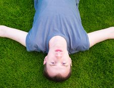 Free Young Man Lying On Grass Stock Images - 19631424