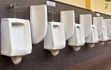 Free Row Of White Porcelain Urinals Stock Image - 19634811