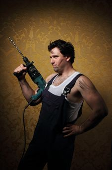 Builder With Professional Puncher-hammer Royalty Free Stock Photos