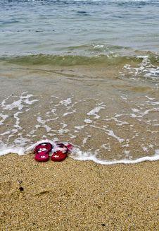 Free Flipflops In Ocean Water Stock Photos - 19636343