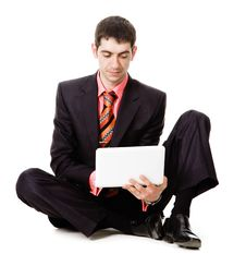 Free A Young Man Watches At A Laptop. Stock Photo - 19639780