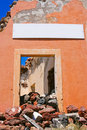 Free Damaged Entrance With Empty Billboard In Santorini Stock Photos - 19642663