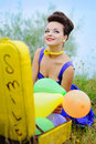 Free Girl With A Yellow Suitcase And Colorful Balloons Stock Photography - 19649822