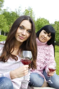 Free Mother And Daughter Drinking Wine Outdoors Royalty Free Stock Photography - 19641447