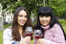Free Mother And Daughter Drinking Wine Outdoors Royalty Free Stock Images - 19641459