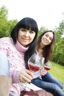 Free Mother And Daughter Drinking Wine Outdoors Royalty Free Stock Photography - 19641497