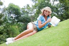 Free Woman On A Grass Looking Over The Book Stock Photography - 19643052