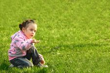 The Child A Smelling Flower In A Green Grass Royalty Free Stock Images