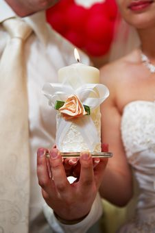 Free Candle In Hands Of Newlyweds Stock Photography - 19645532