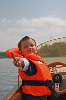 Free Boy In Life Jacket Pointing Out Royalty Free Stock Photography - 19646027