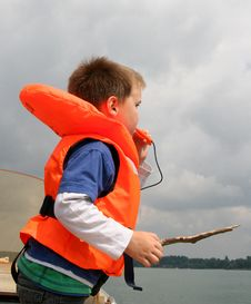 Boy In Life Vest Blowing A Whistle Stock Image