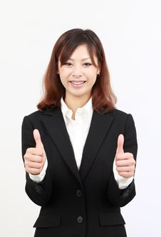 Free Smiling Asian Business Woman Giving Thumb Up Stock Photography - 19647312
