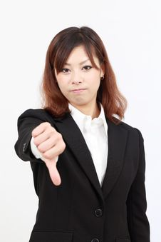 Free Young Asian Business Woman Showing Thumb Down Stock Image - 19647341