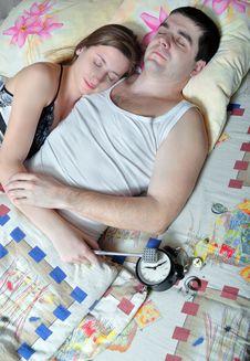 The Young Pair Has Broken An Alarm Clock Royalty Free Stock Photos