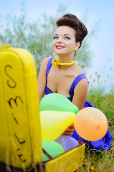 Girl With A Yellow Suitcase And Colorful Balloons Stock Photography