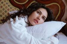 Free Beautiful Woman Lying On A Bed In A White Bathrobe Royalty Free Stock Photo - 19649925