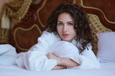 Free Beautiful Woman Lying On A Bed In A White Bathrobe Royalty Free Stock Photo - 19649935