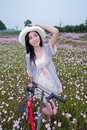 Free Girl In Garden With Bike Stock Images - 19654004