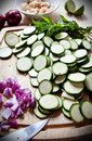 Free Food Preparation: Courgettes And Onions On A Board Stock Photo - 19658090