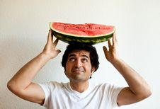 Free Man Holding A Watermelon On His Head Royalty Free Stock Image - 19651326