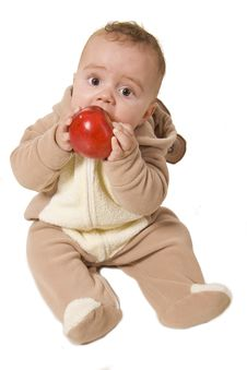 Baby Holding And Eating An Apple Royalty Free Stock Photography