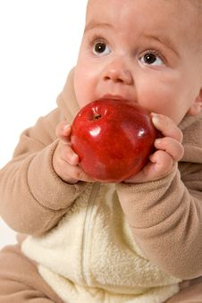 Baby Holding And Eating An Apple Stock Photo