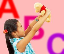 Free Girl Holding Her Teddy Bear Up In The Air Royalty Free Stock Images - 19652869