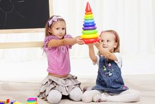 Free Two Little Girls Play With Toys Royalty Free Stock Photos - 19654108