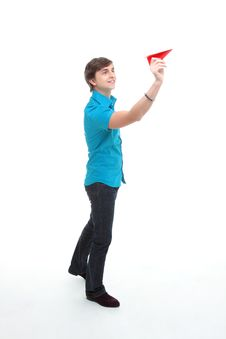 A Young Man Holding A Paper Airplane Royalty Free Stock Photography