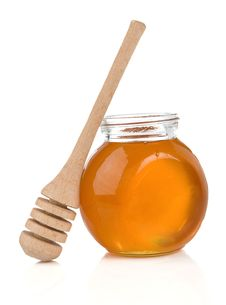 Pot Of Honey And Stick On White Stock Images