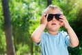 Free Boy Sunglasses In The Summer Park Stock Photography - 19661652